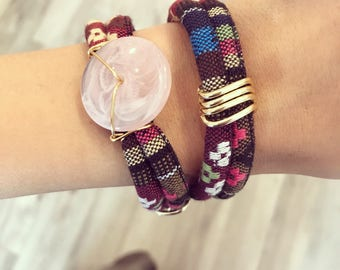Patterned wrapover bracelet with a baby pink bead