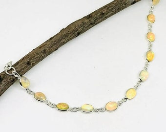 10% Ethiopian Opal bracelet in sterling silver 925. Length - 6 to 8 inch. Natural authentic Ethiopian opal perfectly matched.