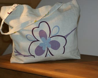 Beige cotton canvas shoulder bag and purple and green flower print.