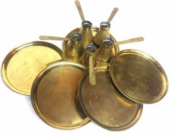 "Antique Turkish brass coffee set that includes five coffee pots and five plates.  ""Ezerka Ohrid"" is embossed on each of the handles."