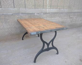 vintage industrial reclaimed dining table top on cast iron machine legs