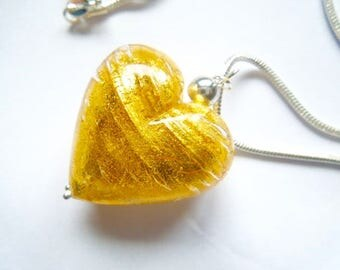 Large gold Murano glass heart pendant with sterling silver.