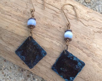Brass earrings with Robin's egg blue patina  harms and light blue cat eye beads