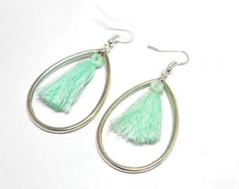 Earrings drops and green pompon water