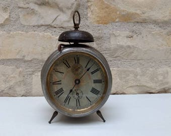 Shabby chic French antique, single bell on top, mechanical alarm clock, decorative item circa early 1900s.