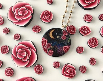 Roses in space. Handmade polymer clay pendant and handmade rose charm on sterling silver ball chain