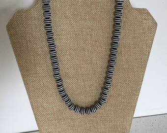 A Black and White Striped Beaded Necklace.