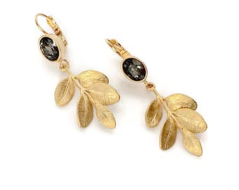 Stud Earrings in gold tone metal with cabochon Swarovski Crystal silver night and leaf pendants