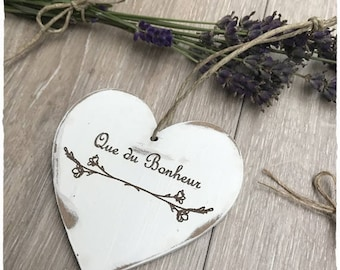 Weathered white wooden heart with engraving * happiness that *.