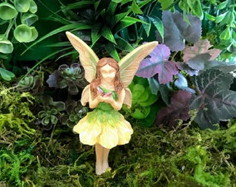 Miniature Fairy in Yellow & Green with a Purple Butterfly