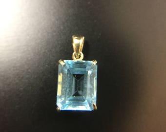 14K gold blue topaz pendant