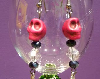 Earrings in Platinum metal skull fuchsia faceted beads and feather charm