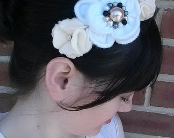 White and tan felt flowers with beading on black headband