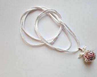 Bola pregnancy necklace