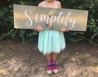 Simplify hand lettered wood sign