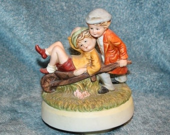 "Whimsical Couple Music Box Porcelain Plays Theme from ""Love Story"""