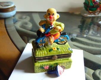 Circus Clown on his scooter with a top trinket