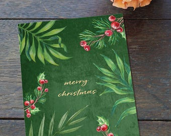 Tropical Christmas card with green foliage and winter berries, Tropical holiday greeting card with palm leaves green velvet background