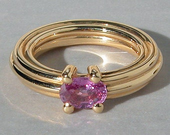 Ring yellow gold and Pink Sapphire oval