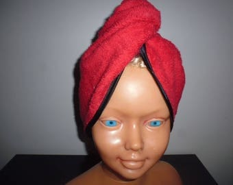 Towel embellished red head with a black satin custom bias
