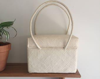 Vintage woven cream bag