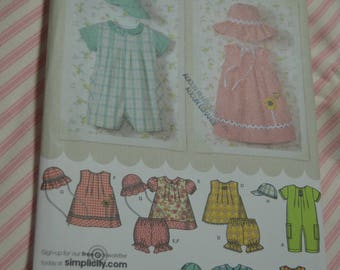 Simplicity 4243 Babies Romper in Two Lengths Dress Top Panties and Hats Sewing Pattern - UNCUT  - Size XXS XS S M L