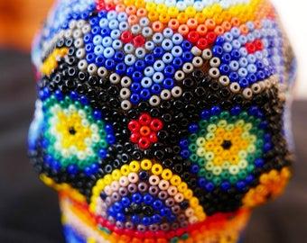Skull rock type glass bead
