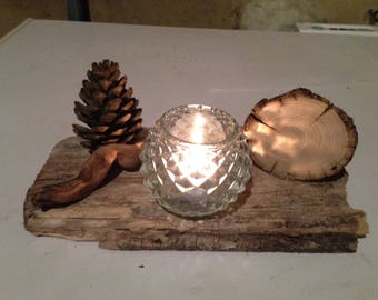 Glass candle jar with pine cone, log, floated wood