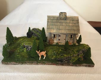 Large diorama of mountain cabin