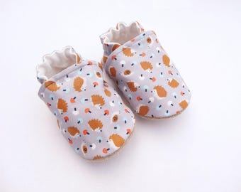 Sole leather baby booties and grey cotton top with hedgehogs