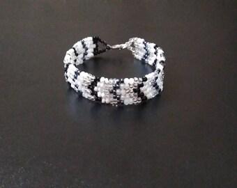 Black, grey, silver and white bracelet