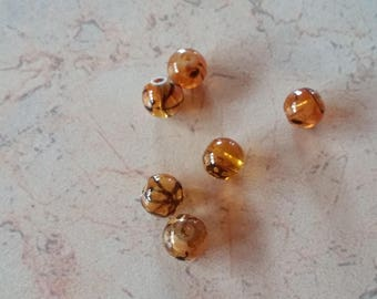 Marbled black 6mm amber colored glass beads