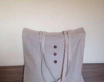 beige bag with white polka dots
