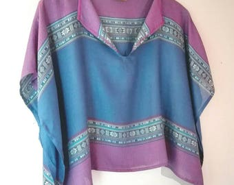 Top runs large and lightweight type poncho, blue and purple