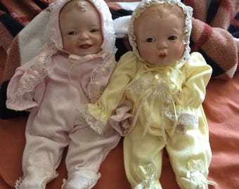 Baby boy and girl porcelain dolls