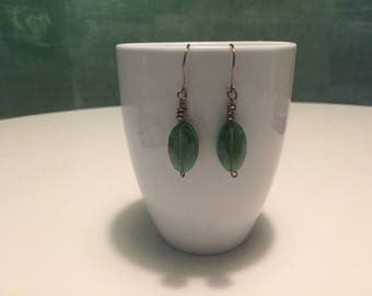 Green brass wire wrapped dangle earrings