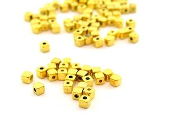 25 golden metal 4mm cube beads