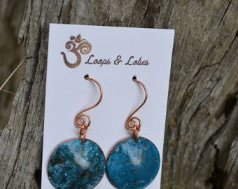 Turquoise patina on copper discs
