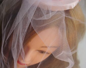 Pink satin hair fascinator with veil