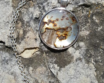 Found Metal and Hornet Nest Paper Pendant in Silver