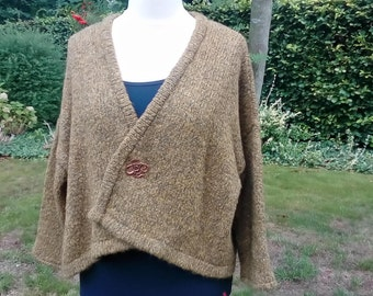 Handknitted green cardigan with Viking-style pin