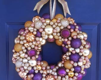 Designer luxury all winter ornament wreath or Christmas wreath. Gold, blush, and purple shatterproof ornaments with bow for hanging. Nice!