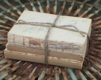 Unbdound Book Centerpiece, Stack of 3 Vintage Unbound Books Wrapped in Twine, Rustic Wedding Centerpiece, Naked Book Stack