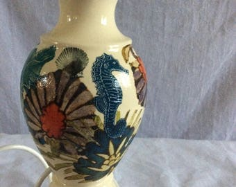 Unusual vintage lamp base decorated with sea theme detail.