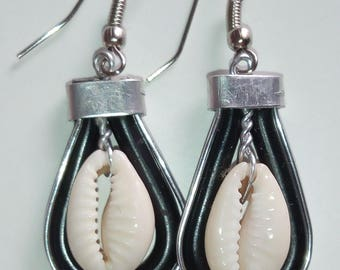 A pair of African style earrings - with cowries