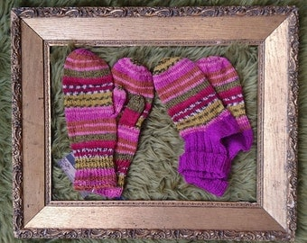 Hand-knitted woollen pink socks and mittens