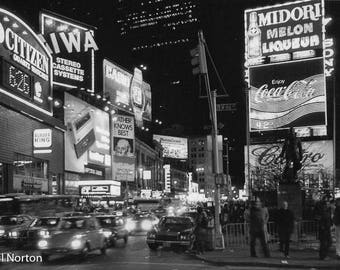 Times Square 1978, neon lights before today's high definition jumbotrons, and unchanging round-the-clock traffic in the Big Apple photo.