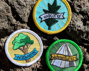 adventurer - round embroidered iron-on patch featuring mountain
