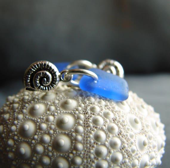 Little Nautilus sea glass earrings in cobalt blue