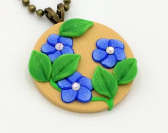 Indigo Flower Necklace, 1.25 Inch Diameter; Medallion; Polymer Clay Pendant; Floral Necklace; Springtime Fashion; Style #: BLF07